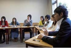 Honing their presentation skills through small seminar classes that offer question and answer sessions between students.
