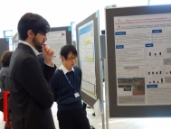 Presenting posters at an international academic conference.